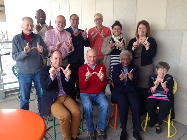 "Sociology Department Board of Visitors giving the ""W"" sign with their hands"