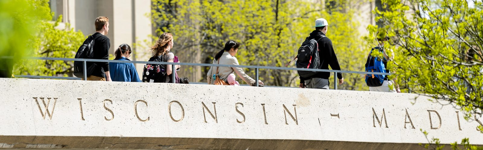 Students walk across the North Park Street pedestrian overpass bridge that links Bascom Hill, at left, and the Mosse Humanities Building, at right