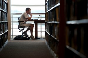 graduate student studying in library