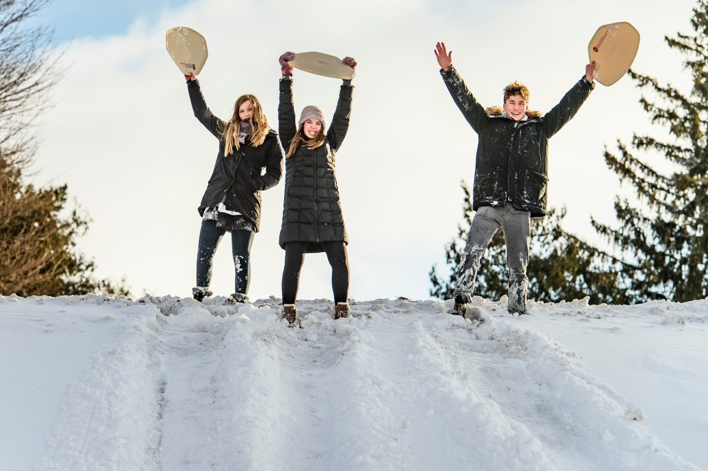 UW students sledding on Observatory Hill